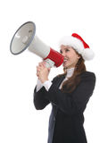 Xmas woman with megaphone. Attractive young woman in Santa hat with large megaphone isolated on white background Royalty Free Stock Photography