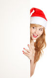 Xmas woman peeking from behind blank Stock Photos
