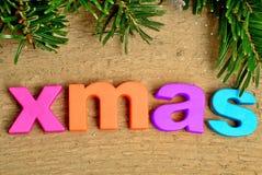 Xmas word with branch tree Royalty Free Stock Photos
