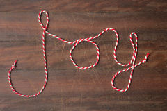 Xmas word Joy spelled out in festive string Stock Photography