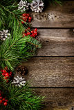 Xmas wreath card  with copyspace on wooden background. Stock Photography