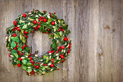 Xmas wreath on a wooden background Royalty Free Stock Images