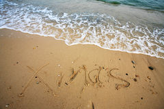 Xmas write on beach Stock Photo