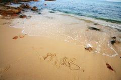 Xmas write on beach Stock Photo