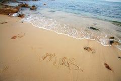 Xmas write on beach Royalty Free Stock Images
