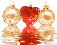 Xmass. Some christmass balls isolated in water Royalty Free Stock Photography