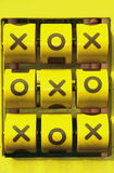 XO game. Yellow x o tic tac toe game Royalty Free Stock Photos