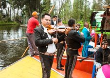 Mariachi guitar players and dancers performs in Xochimilco, Mexi Stock Photography