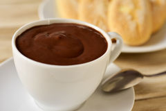 Xocolata i melindros, hot chocolate with typical pastries of Cat. Closeup of a cup of xocolata i melindros, hot chocolate with typical pastries of Catalonia Royalty Free Stock Photography
