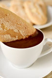Xocolata i melindros, hot chocolate with typical pastries of Cat. Closeup of a cup of xocolata i melindros, hot chocolate with typical pastries of Catalonia Stock Image