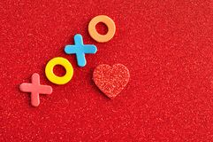 Xoxo hugs and kisses on a red background Stock Photos