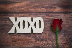 Xoxo  sign on wood floor with rose Royalty Free Stock Photography