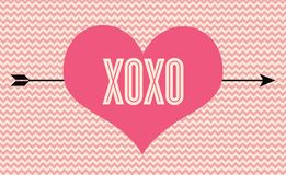 XOXO. Vector illustration of a heart with an arrow through it. It reads XOXO (hugs and kisses) and it has a chevron pattern as background Royalty Free Stock Images