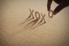 XOXO YOU wood word on compressed board Royalty Free Stock Photo