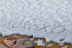 Xoxoxo meaning Hugs And Kisses written  in the snow Stock Photo
