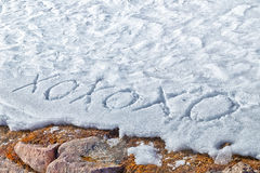 Xoxoxo meaning Hugs And Kisses written  in the snow Royalty Free Stock Photo