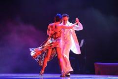 Xpress lycka-identitet av dentango dansdramat Arkivfoton