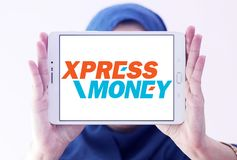 Xpress Money company logo. Logo of Xpress Money company on samsung tablet holded by arab muslim woman. Xpress Money is a global money transfer company Royalty Free Stock Photo