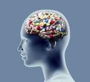 Xray of human head with pills and drugs for brain. Royalty Free Stock Photos