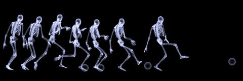 Xray of human skeleton playing soccer Stock Image