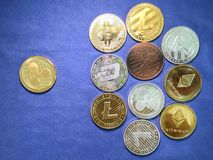 XRP ripple coin and others crypto coin on blue cloth. Virtual cr Royalty Free Stock Photo