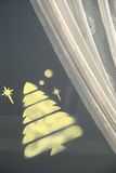 Xtmas tree on window Stock Photos