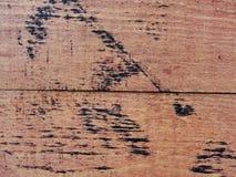 Xture Beschaffenheit der roten hölzernen Plankenwand, rustikale Struktur mit den Spuren des Bitumens umfasst Stockbilder