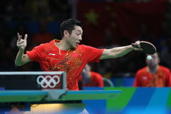 Xu Xin playing table tennis at the Olympic Games in Rio 2016. Royalty Free Stock Photos