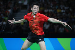 Xu Xin playing table tennis at the Olympic Games in Rio 2016. Xu Xin from China playing table tennis at the Olympic Games in Rio 2016 Stock Images