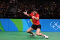 Xu Xin playing table tennis at the Olympic Games in Rio 2016. Xu Xin from China playing table tennis at the Olympic Games in Rio 2016 Stock Image