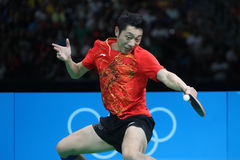 Xu Xin playing table tennis at the Olympic Games in Rio 2016. Xu Xin from China playing table tennis at the Olympic Games in Rio 2016 Royalty Free Stock Photo
