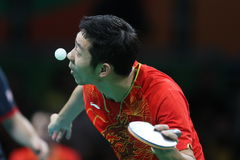 Xu Xin playing table tennis at the Olympic Games in Rio 2016. Xu Xin from China playing table tennis at the Olympic Games in Rio 2016 Royalty Free Stock Photography