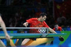 Xu Xin playing table tennis at the Olympic Games in Rio 2016. Xu Xin from China playing table tennis at the Olympic Games in Rio 2016 Royalty Free Stock Image