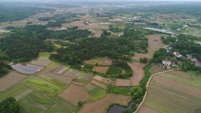 Rural scenery in central China, aerial photography. Xuancheng, Anhui Province, China, Tianyuanfengguang. Looking down from the air, villages, paddy fields, and stock footage