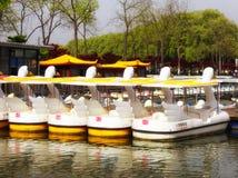 Xuanwu Lake sightseeing Boats. Geese shaped sightseeing boats parked on the dock by Xuanwu Lake in nanjing city jiangsu province China Stock Images
