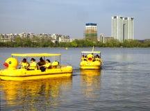 Xuanwu Lake sightseeing Boats. Tourists taking duck shaped sightseeing boats over Xuanwu Lake in nanjing city jiangsu province China Royalty Free Stock Photo