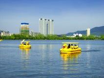 Xuanwu Lake sightseeing Boats. Tourists taking duck shaped sightseeing boats over Xuanwu Lake in nanjing city jiangsu province China Stock Photography