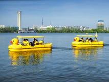 Xuanwu Lake sightseeing Boats. Tourists taking duck shaped sightseeing boats over Xuanwu Lake in nanjing city jiangsu province China Royalty Free Stock Photography