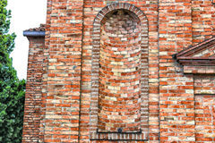 XVIII century chaplaincy church in Italy. Architecture details of the brickwall facade of a XVIII century  chaplaincy, church in the village of  Cà di Lugo near Royalty Free Stock Image