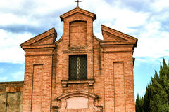 XVIII century oratory church in Italy. Brickwall facade of an early XVIII century  oratory, church dedicated to St. Dorothea  in the village of  Belricetto near Royalty Free Stock Photography