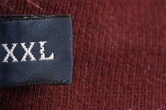 XXL. The XXL tag on a men's sweater Stock Image