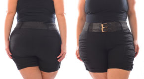 XXL woman black short pants with black belt on plus size model isolated on white Royalty Free Stock Image