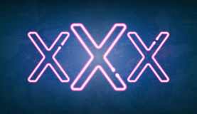 XXX glowing neon light street sign Royalty Free Stock Photo