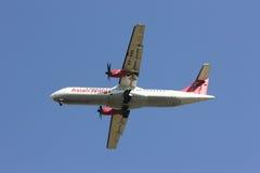 XY-AIU ATR72-200 des ailes asiatiques Image libre de droits