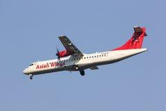 XY-AJQ ATR72-200 des ailes asiatiques Images libres de droits