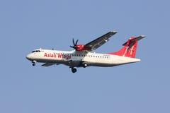 XY-AJQ ATR72-200 des ailes asiatiques Photos stock