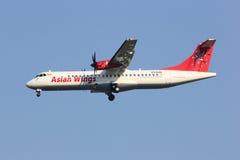 XY-AJQ ATR72-200 des ailes asiatiques Photo libre de droits