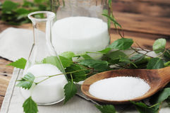 Xylit (birch sugar) on a wooden spoon Royalty Free Stock Photography