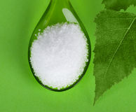 Xylitol birch sugar on green plastic spoon Royalty Free Stock Photo
