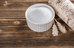 Xylitol. In white bowl with candy sugar sticks stock photo
